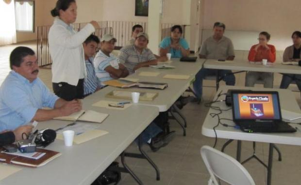 Doña Emilia in a group meeting with leaders of local municipalities.