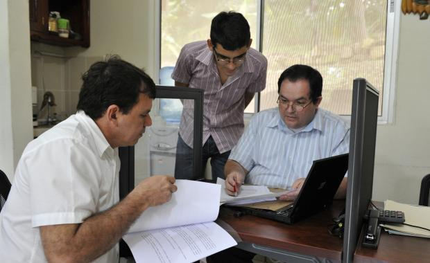 Lic. Migdonio, German and Martin (from left) reviewing accounts and human resource documents.