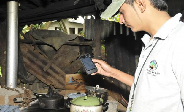 Every stove technician has a smart phone to collect GPS location and household data for every stove. (C. Boulton photo)