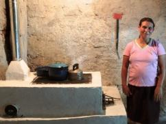 A mom, pregnant with her 10th child by her clean stove.